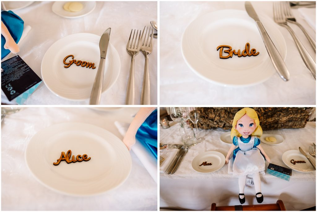 table styling details in Eaves Hall dining room showing wooden place names and an alice in Wonderland toy