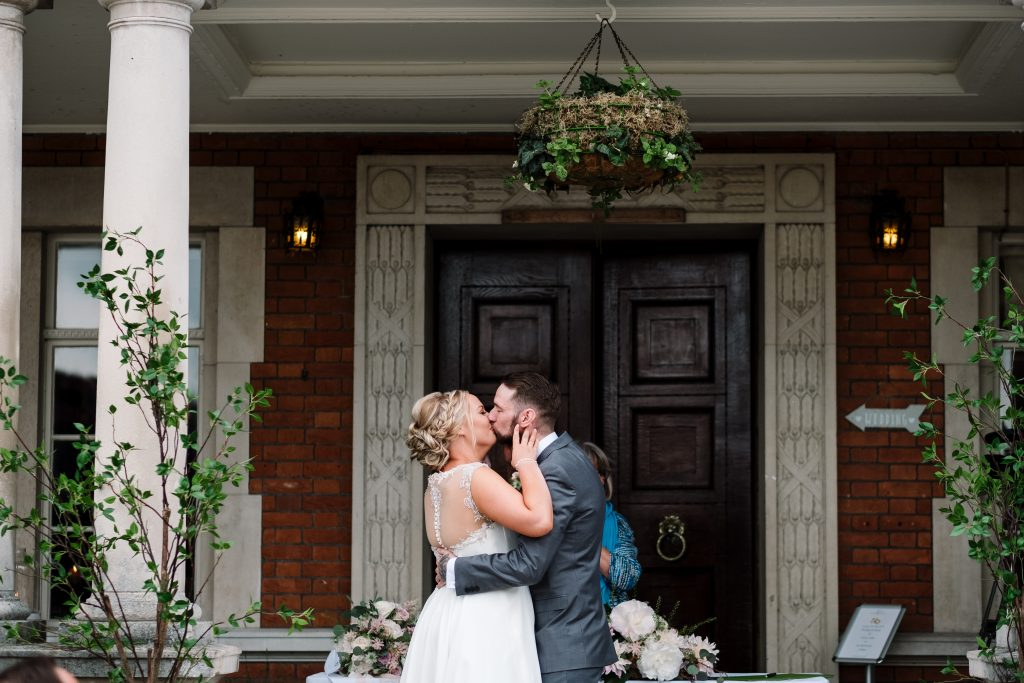 bride and groom kiss at the end of their wedding ceremony at Eaves Hall wedding venue