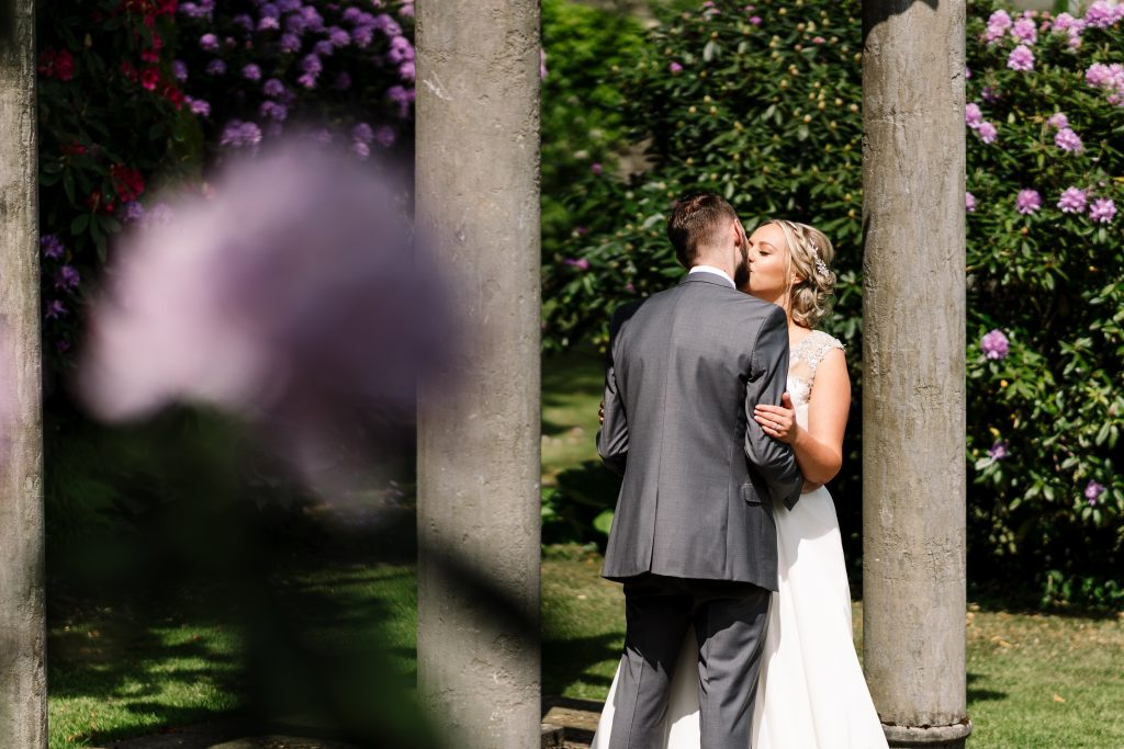 bride and groom portrait in the gardens at their outdoor wedding