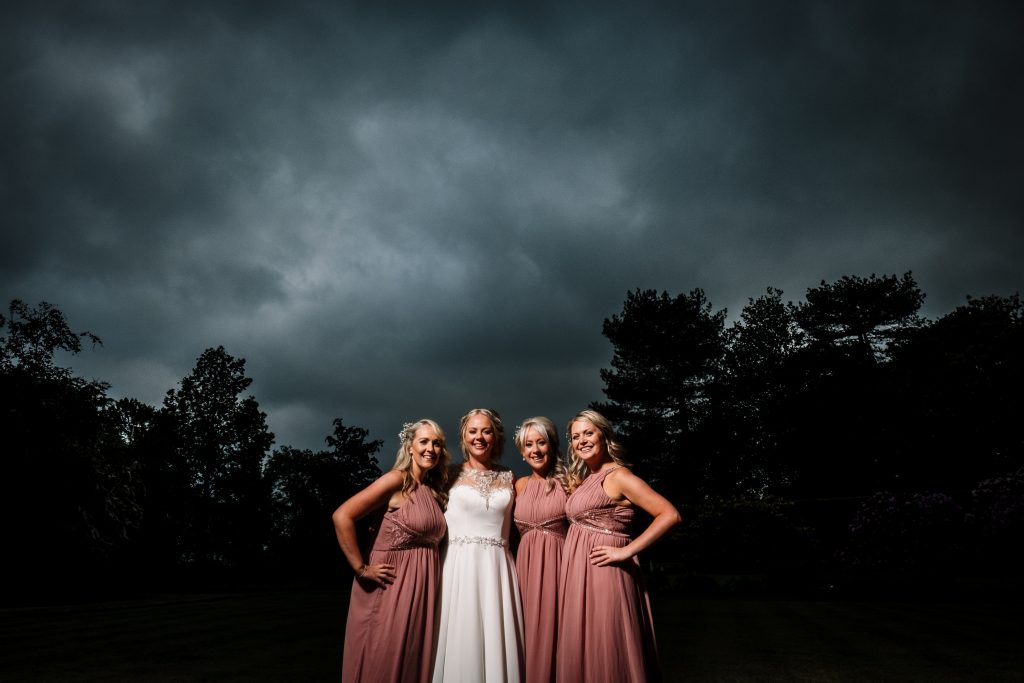 group photos of bride and bridesmaids in the evening at Eaves Hall