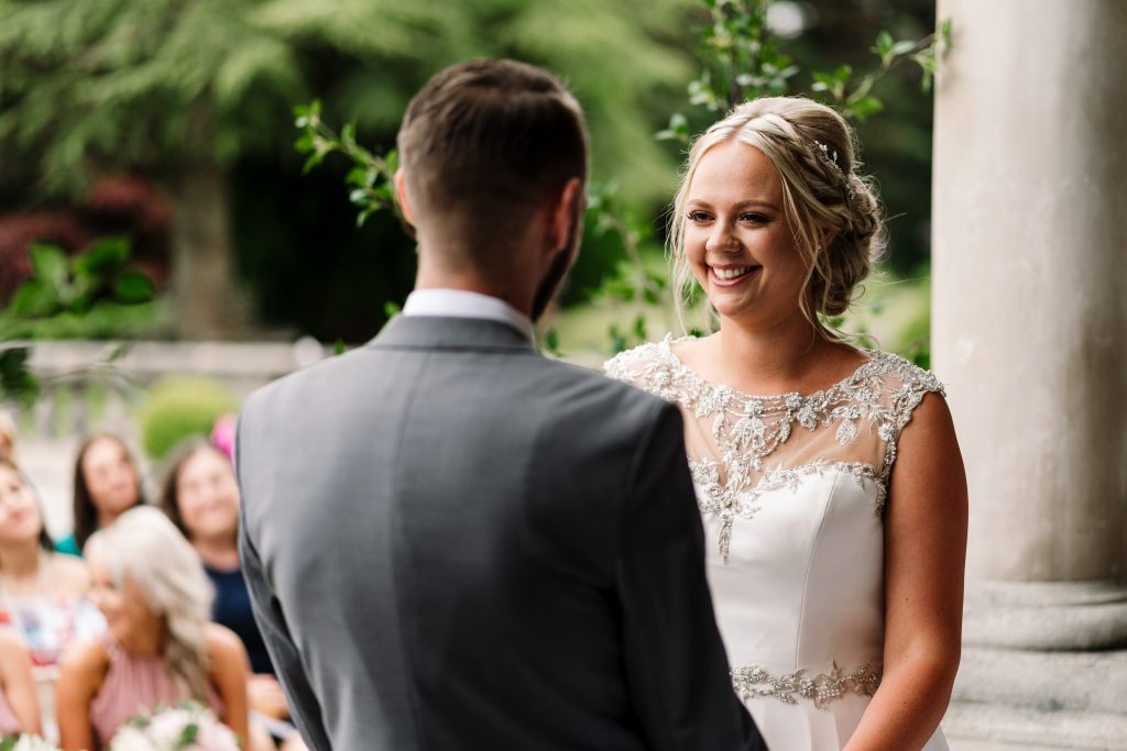 bride and groom exchange vows at their Eaves Hall Wedding