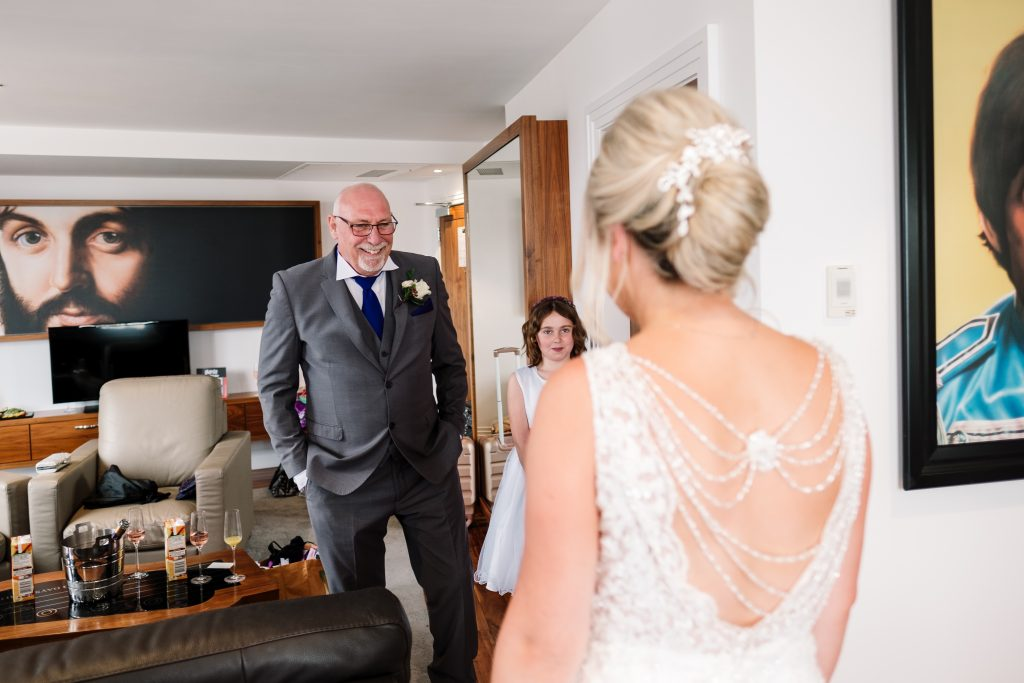 brides Dad sees daughter in her dress for the first time at the Hard Day's Night hotel