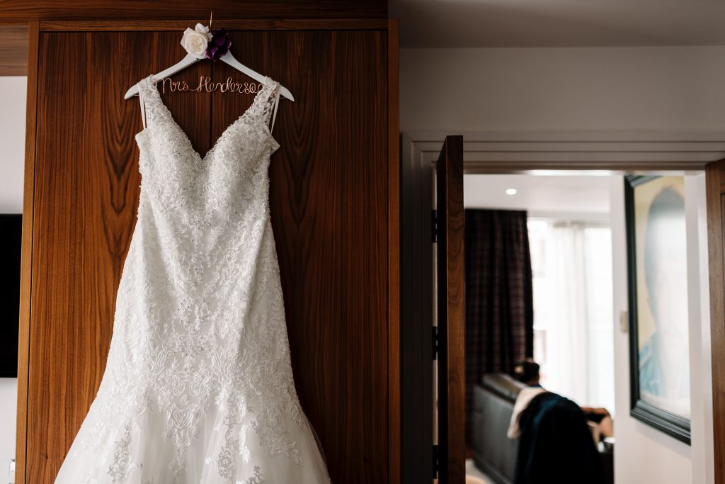 brides dress hanging up in the McCartney suite on the morning of the wedding