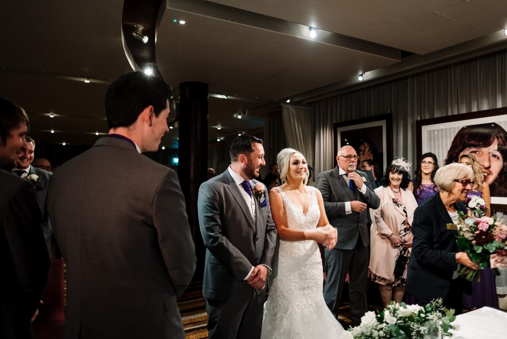 bride and groom during their wedding ceremony in the Zygmant suite