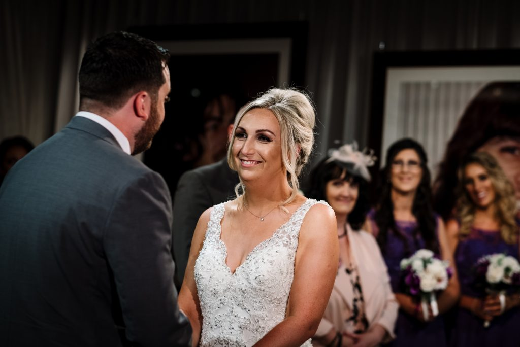bride says her vows to groom during wedding ceremony in the Zygmant suite