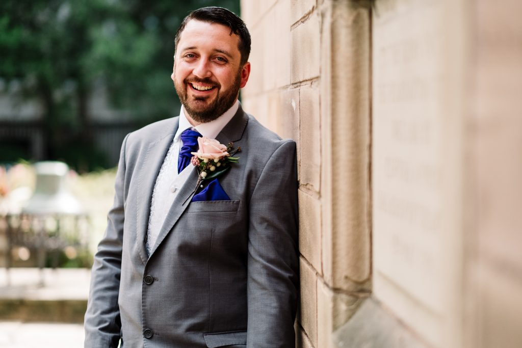 groom portrait outside St Nicks church in Liverpool