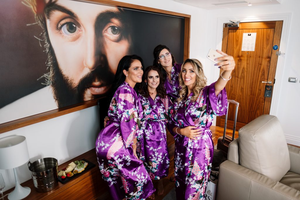 bridesmaid selfie with John Lennon during wedding preparations