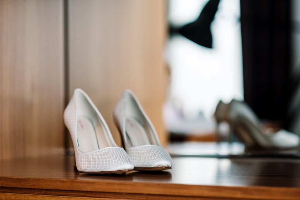 brides white shoes in the McCartney suite at the Hard Day's Night Hotel